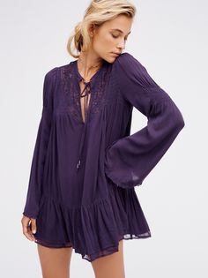One Night Victorian Tunic   Super femme, Victorian-inspired tunic. Features a semi-sheer crinkly fabrication with pretty crochet and lace details around the open neckline. Front beaded ties and back cutout with a small grommet detail. Sweet ruffled hem.