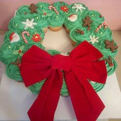 24 cupcakes, fondant decorations, real candy canes and a fake bow.