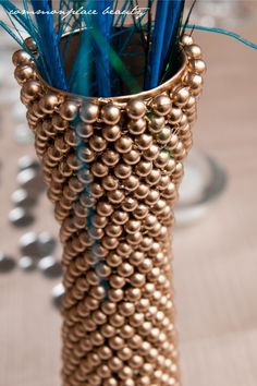 DIY $ Store vase. Cute in gold, or fake pearls for an event centerpiece. Preference, formal, scholarship banquet?