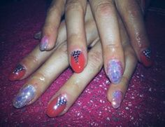red geil nails decorated with honey petals and  Swarovskis' rhinestones :)