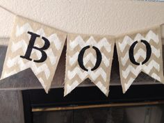 This banner is three feet long, each panel is 9 x 11. It is natural burlap painted with a white chevron background and black letters. Chevron