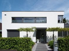 Renovatie • modern • gevelpleister • plat dak • Foto: www.verelst.be