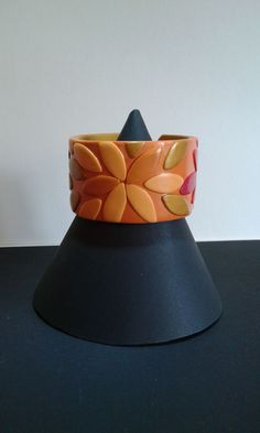 armband leafs orange via diferente. Click on the image to see more!