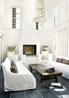 Contemporary Living Room with Cement fireplace, double-hung window, Fireplace, High ceiling, Unruh Farmhouse Coffee Table