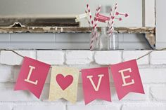 Photo prop for families to hold  Free Printable LOVE Valentine Banner in Red and Gold Glitter