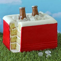 Cooler Cake - This red Cooler Cake looks pretty real filled with isomalt ice cubes and shiny modeling chocolate beer bottles and is the perfect dessert for a tailgating party