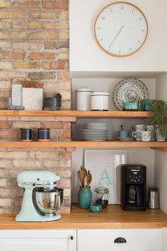 Love this shelving, countertop and cabinet combination - Chill Scandinavian Meets Mid-century Style | Apartment Therapy