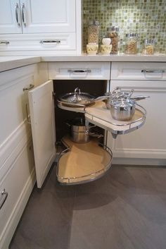 """Not your Mother's Lazy Susan Cabinet."" Like the fact that this one has shelves to pull out for access and cleaning."