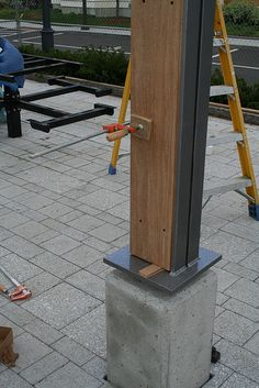 Concrete base @ wood and steel angle column by gap123, via Flickr
