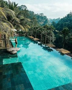 Whether or not a pool adds value to a home is dependent on where your home is. If you're planning to put in a pool, employ a reliable pool contractor. The shimmering swimming pool and lovely … Hotel Swimming Pool, Luxury Swimming Pools, Luxury Pools, Hotel Pool, Dream Pools, Swimming Pool Designs, Ubud, Hotels And Resorts, Best Hotels