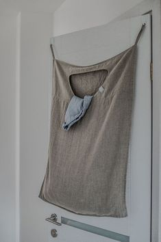 Hanging linen laundry bag. DESCRIPTION: -100 % natural Lithuanian linen (flax); - washed, soft and has natural wrinkles; - simply finished; -