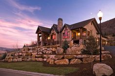 I think have large rocks wall similar to this would elevate the house and also make the landscape look more natural @Liza Weatherston @Ryan Mackerell