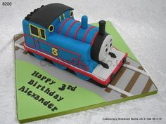 Shaped Thomas the tank engine cake http://www.cakescrazy.co.uk/details/thomas-the-tank-engine-cake-8200.html