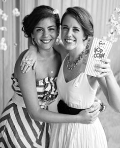 Carnival-inspired bridesmaid dresses: Private Gallery, B Boutique. Popcorn makes for a fun prop in a photo booth! #wedding