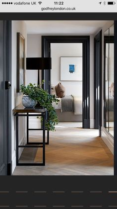 Black door jams with white baseboards