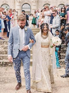 Elegant Interfaith Wedding with Two Ceremonies in the English Countryside.  // Beautiful wedding recessional with flower petals on the happiest bride and groom. Interfaith wedding recessional. Hindu wedding ceremony. Beautiful Sari.