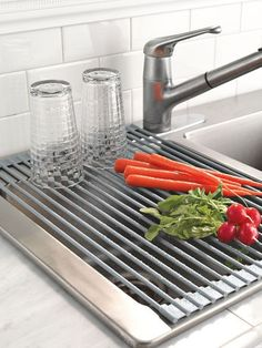 Space-saving dish drying rack rolls up, but opens to hang over the sink. Steel with no-scratch silicone coating. Use for pots, pans, china and crystal.