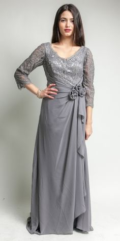 A lovely lace dress for a lovely lady! A mother's gown by Night Scene that is figure flattering!