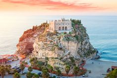 The fairytale Santa Maria dell'Isola at sunset on Tropea beach, Calabria, southern Italy