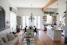 HGTV's Chip and Joanna Gaines knocked down walls in their Texas farmhouse to form this inviting living/dining/kitchen space.
