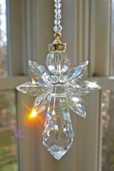 NEW.... Long Gold Trimmed Angelina - 9 Swarovski Crystal Angel Suncatcher. $28.00, via Etsy.