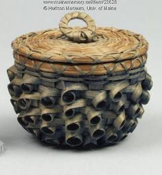 Penobscot button basket, ca. 1934. Penobscot Indian Theresa Camilla Lyon Sockalexis made this button basket, part of a set of sewing baskets that includes a needle case, thimble holder, pin cushion and scissors case in addition to this basket. Item # 23628 on Maine Memory Network