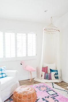 There are so many different elements going on this in this boho baby girl nursery, but it ALL WORKS together!