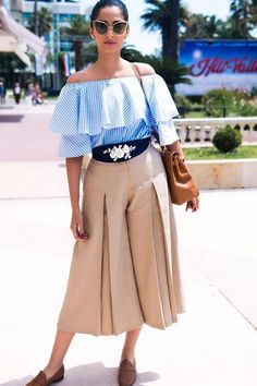 58ecc1dd50af Sonam Kapoor at Cannes 2016 wearing flared nude pants with stripe off  shoulder top by Atsuse Khose