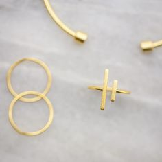 """Gold everything ✨ : Asymmetrical Bar Ring ($14); Barrel Cuff ($18); Concave Rings ($13)"""