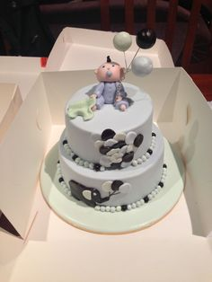 Christening / Baptism cake with elephants and balloons.  Baby boy cake topper made of fondant.