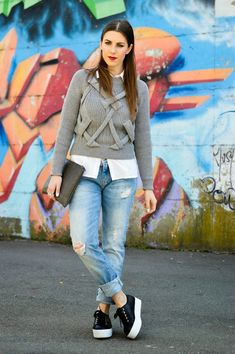 Boyfriend jeans, classic white shirt, grey round neck sweater and  black flatform Supergas - transcending this outfit from casual to chic.
