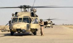 A pair of US Air Force Reserve Sikorsky HH-60G Pave Hawk helicopters from the 301st Rescue Squadron, Patrick AFB, Fla., take part in the initial combat phase of Operation Iraqi Freedom. The reservists operated out of Tallil Air Base, Iraq, immediately after the base was secured by coalition ground forces. (U.S. Air Force photo/Staff Sgt. Shane Cuomo)