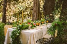 love the greenery for this table runner - and the gold candles!