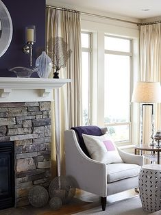 living room by Sarah Richardson... i love the stone in the fireplace