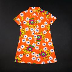 "Bright orange floral 70's shift dress.Made in France.This ray of sunshine comes in a good vintage condition. Some tiny little snags as can be seen in the picture, easy to put back with this kind of fabric though.Fabric: PolyesterBrand: CarabiSize: Tag says 144. Would approximately fit best to a 10 year old girl.To be sure please check measurements taken below.Shoulder to Hem: 70cm (27,5"")Armpit to armpit: 39cm (15,5"")Shoulder to shoulder: 32cm (..."