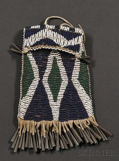 Southwest Beaded Hide Strike-a-Lite Bag, Ute or Mescalero Apache, c. last quarter 19th century, beaded on the front and flap with a ...