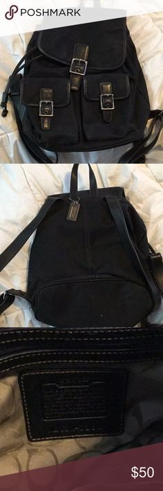 Canvas and leather Coach backpack purse. This is an extremely well-made Coach backpack purse. The body is mainly canvas, but the hardware and straps are leather. The interior fabric has the Coach logo with the leather nameplate on the inside. It shuts with magnetic fasteners. Coach Bags