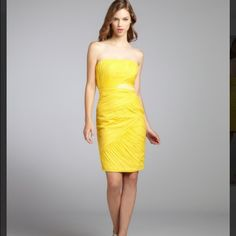 Strapless yellow Monique Lhuillier cocktail dress Ruched canary yellow cocktail dress with beaded embellishments. Tags still attached. Comes with built in brassier and extra beads and well as straps. In excellent condition. 100% silk with a polyester lining. Truly a beautiful dress at an amazing price Monique Lhuillier Dresses Strapless