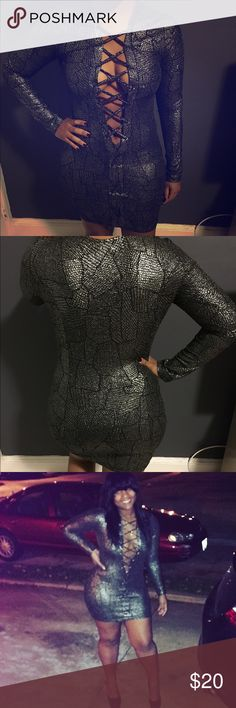 Snakeskin print silver and black long sleeve dress Eye stretchy mini long sleeve dress. The front is cut out with lace up front to reveal the front. Very stretchy material. Glitter. Design is like snake skin (but not material)  and the colors are silver and black (gently used, worn once) Dresses Long Sleeve