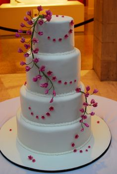Eastern Redbud Wedding Cake--think this is ugly, but love the ideas behind the twisting up and above the cake