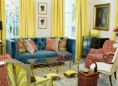 Wonderful primary color combination of yellow, red and blue with black accent chest and lampshade. My problem is that is looks too crowded; like I'd trip over a stool or chair.
