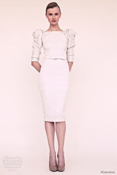 Knee length dress with elbow length sleeves.