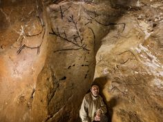 """Photograph by Stephen Alvarez. Source: Department of Education, Culture, and Sport of the Government of Cantabria, Spain The artists of the Upper Paleolithic sometimes left their work in intimate enclosures, such as this recess no bigger than a small closet in Las Chimeneas Cave near El Castillo. Marcos García Diez of the University of Basque Country focuses on such """"private art."""""""