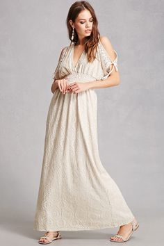 3cd1832cdba6 A maxi dress crafted in a guipure lace featuring a V-cut front and back