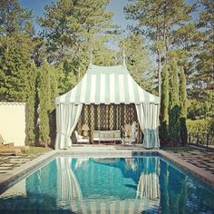 Love striped pool tents. -A.A. inspired