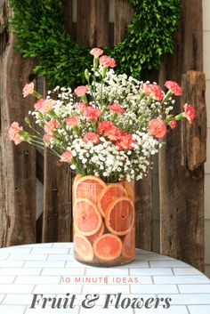DIY Floral and Citrus arrangement. Love the bright pink grapefruit on the bottom. Cute gift idea for Mother's Day or Valentines Day. You can get away with more affordable flowers and make it look more expensive with the fruit in the vase.