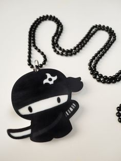Hey, I found this really awesome Etsy listing at https://www.etsy.com/listing/114697956/cute-ninja-charm-necklace