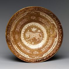 Bowl with lion, Seljuq period (1040–1196), early 13th century.  Attributed to Iran, Kashan.  Stonepaste; overglaze luster-painted on opaque white glaze.  The Metropolitan Museum of Art.
