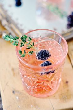 Blackberries and thyme: http://www.stylemepretty.com/living/2015/06/18/19-easy-garnishes-to-dress-up-your-drinks/