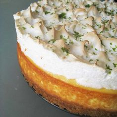 Baked New York Cheesecake Recipe. A Jamie Oliver cheesecake topped with sweet fluffy meringue and lime zest. More baking recipes at The Cake Mistress.